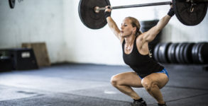 woman doing crossfit snatch